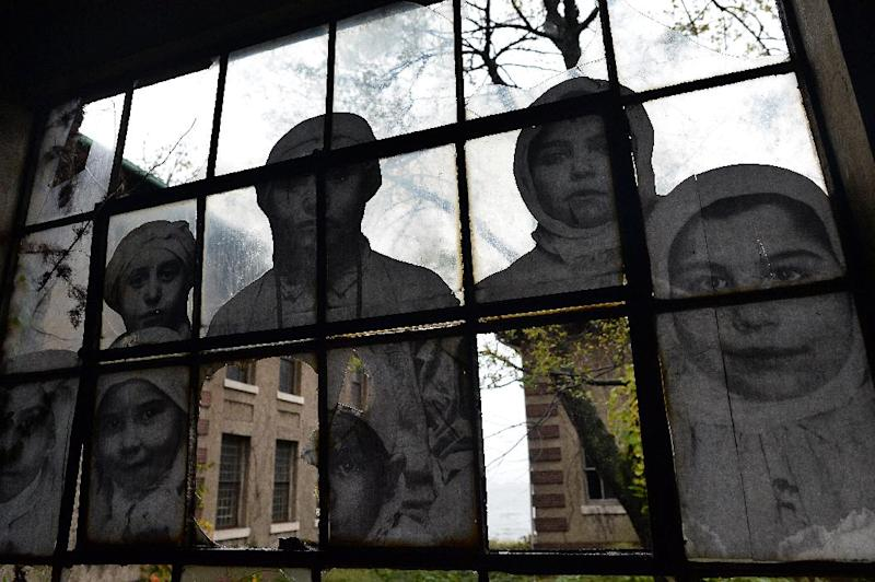 An artwork by French artist JR is pictured inside the Ellis Island Immigrant Hospital during a media tour in New York on October 16, 2014 (AFP Photo/Jewel Samad)