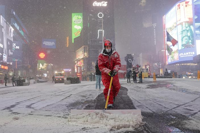 <p>Snow begins to fall in Times Square during a Nor'easter, in New York City on 16 December.</p> (REUTERS)