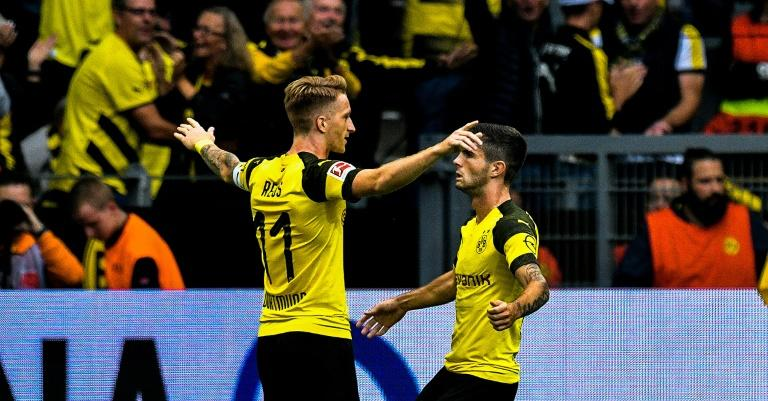 Dortmund captain Marco Reus (L) celebrates after his stunning free-kick flew into the RB Leipzig net via a deflection in Sunday's 3-1 home win