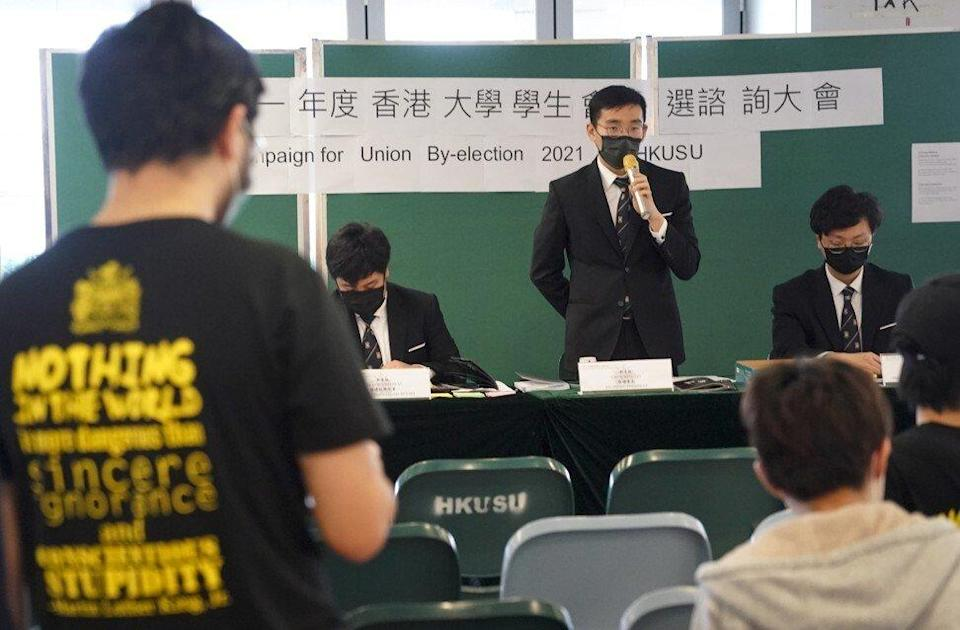 Kwok Wing-ho (pictured with microphone) is aiming to become president of HKU's student union. Photo: Felix Wong