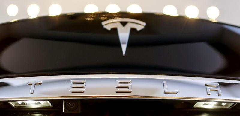 FILE PHOTO: A Tesla logo adorns a 'Model S' car in the dealership in Berlin