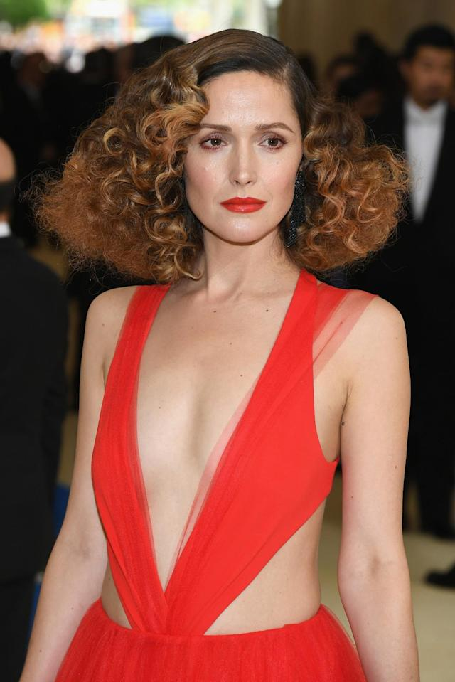 <p>Hello, beautiful! The Aussie actress styled her reddish-tinged locks in voluminous curls and matched her lip color to her red, plunging-neck dress perfectly. (Photo: Getty Images) </p>