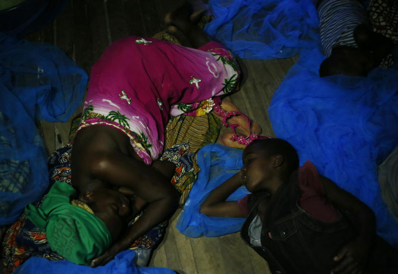 A displaced mother and child, victims of Cyclone Idai, sleep under a mosquito net at the Samora Machel Secondary School which is being used to house victims of the floods in Beira, Mozambique, Sunday March 24, 2019. The death toll has risen above 750 in the three southern African countries hit 10 days ago by the cyclone storm, as workers restore electricity, water and try to prevent outbreak of cholera, authorities said Sunday. (AP Photo/Phill Magakoe)