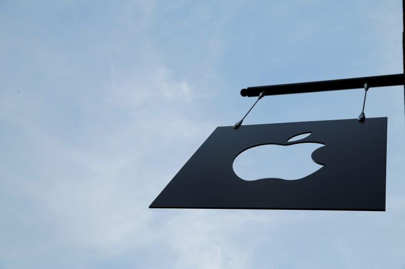 The Apple logo hangs from the front of the new Apple Store Williamsburg in Brooklyn, New York