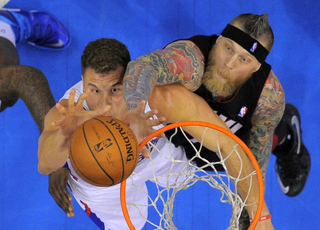 Los Angeles Clippers forward Blake Griffin, left, battles for a rebound with Miami Heat forward Chris Andersen during the first half of an NBA basketball game, Wednesday, Feb. 5, 2014, in Los Angeles. (AP Photo/Mark J. Terrill)