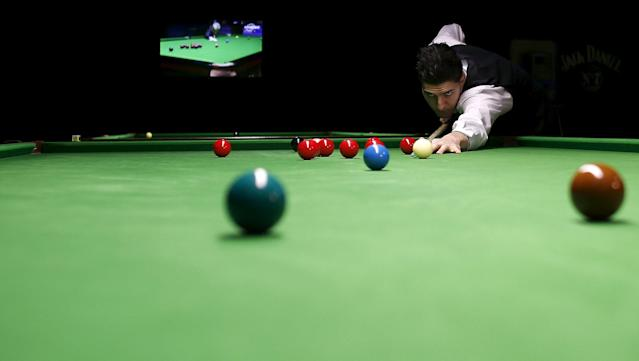 Ivaylo Pekov, 21, the only Bulgarian who competed in the World Snooker Championship plays a shot during a practice session in Sofia, Bulgaria April 30, 2015. Less than 10 years ago, there was probably not a single snooker table in the Black Sea state and many Bulgarians would never have heard of the sport, let alone actually seen a game. Three weeks ago, however, Bulgarian Ivaylo Pekov became only the second player from Eastern Europe to compete in the world championship's qualifiers after Poland's Kacper Filipiak in 2012. Picture taken April 30, 2015. REUTERS/Stoyan Nenov
