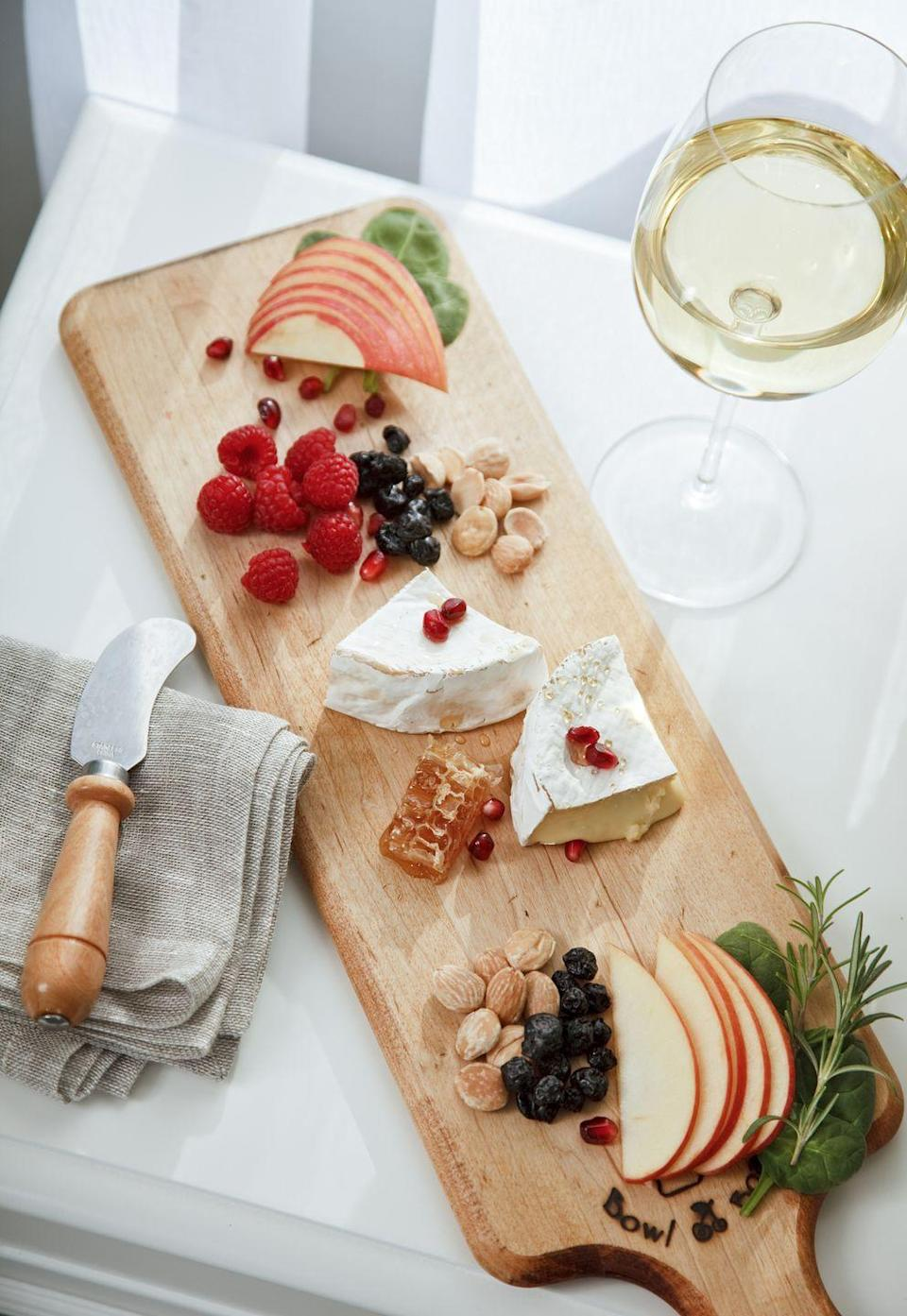<p>There's no better snack to nibble on all day than a charcuterie board. Add whichever treats you like, and don't forget to pair your cheeses and jams with the perfect wines. Not a fan of cheese and crackers? Try a different type of charcuterie board, like one made with candy or desserts. </p>