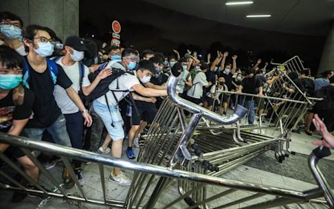 The assembly outside Legco turned disorderly as protesters moved mills barriers. Photo: Dickson Lee
