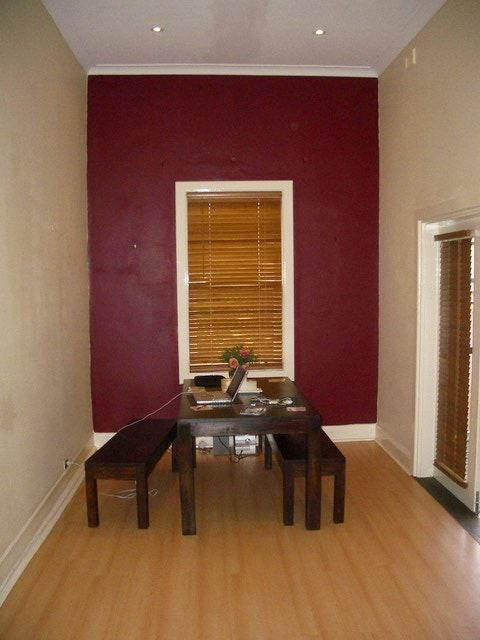 BEFORE: The original door frame limited the amount of light that could enter the dining area, making it a dark and uninviting space.