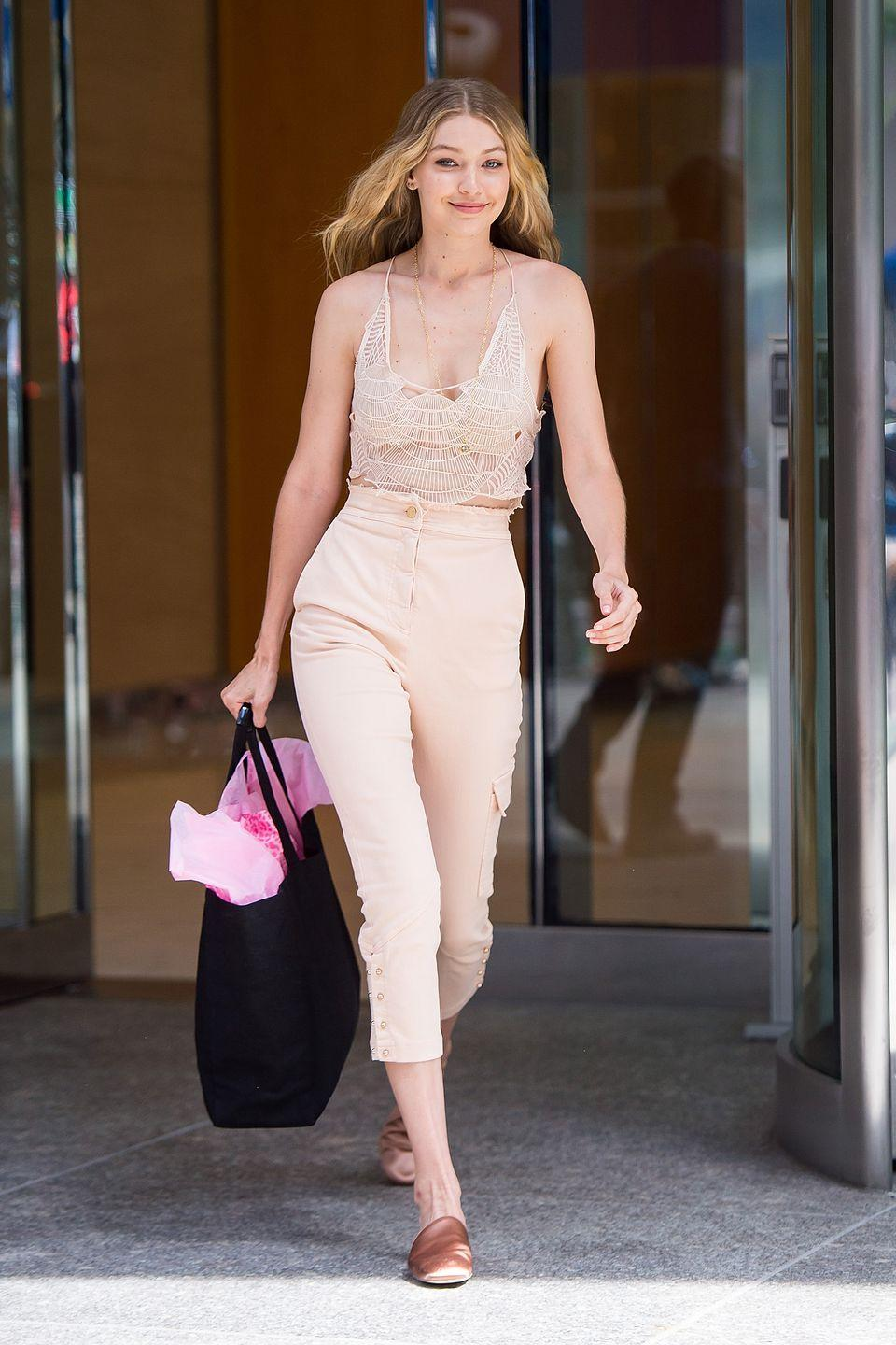 <p>Gigi Hadid is like the 2017 version of Cinderella, but instead of mice sewing her a ball gown, a team of spiders spun this delicate mesh top for her. At any rate, the spiders did a great job and this outfit is crazy cute. </p>