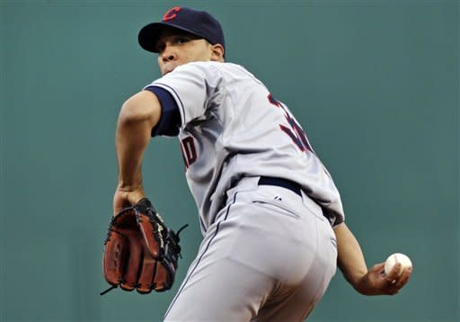 Cleveland Indians starting pitcher Ubaldo Jimenez coils as he delivers to the Boston Red Sox during the first inning of a baseball game at Fenway Park in Boston, Friday, May 11, 2012. (AP Photo/Charles Krupa)