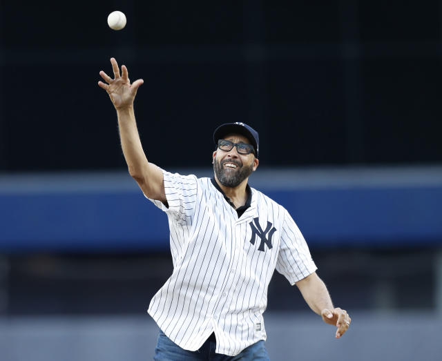 David Fizdale throws out the ceremonial first pitch at Yankee Stadium on Tuesday night. (AP)
