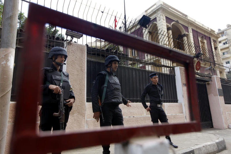 Egyptian policemen guard the Turkish embassy in Cairo, Egypt, Saturday, Nov. 23, 2013. Egypt downgraded diplomatic relations Saturday with Turkey and expelled its ambassador from Cairo, a sharp escalation in tensions between the two countries that mounted after a military coup ousted the country's Islamist president this summer. (AP Photo/Amr Nabil)