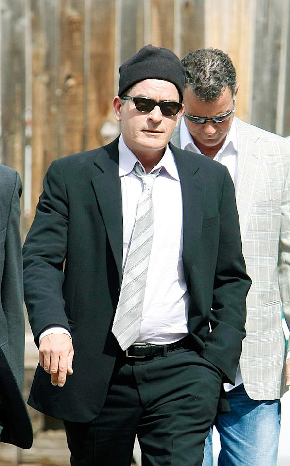 """A disagreement over the terms of Charlie Sheen's proposed work release held up the plea deal in his domestic abuse case, and The Associated Press reports the hearing has now been delayed until July. The troubled star was spotted arriving at the Aspen, Colorado, courthouse Monday. Riccardo S. Savi/<a href=""""http://www.gettyimages.com/"""" target=""""new"""">GettyImages.com</a> - June 7, 2010"""