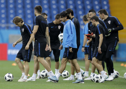 Croatia head coach Zlatko Dalic, center, enter the field with his players for a training session of Croatia at the 2018 soccer World Cup in Rostov-on-Don , Russia, Monday, June 25, 2018. (AP Photo/Natacha Pisarenko)