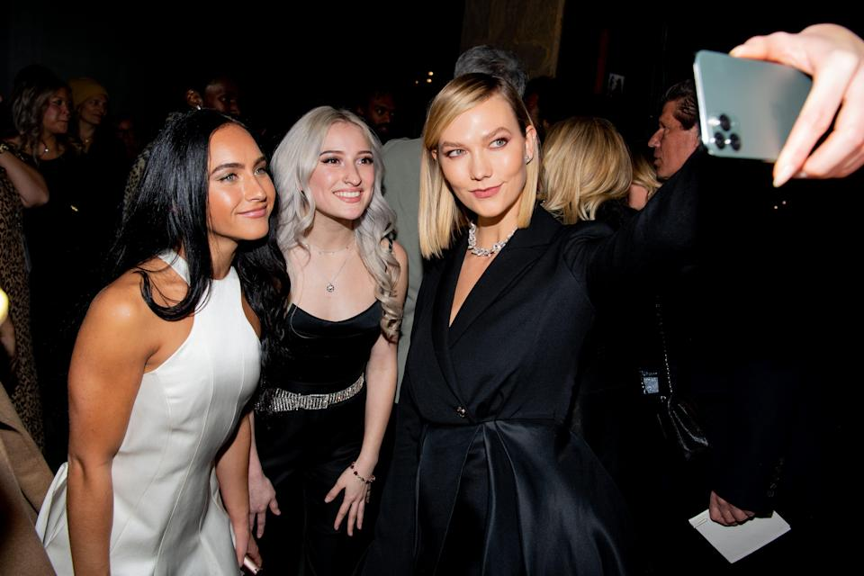 Gabi Butler, Lexi Brumback and Karlie Kloss snap a photo at Brandon Maxwell's Fall/Winter 2020 New York Fashion Week show on Feb. 6, 2020 in New York City.