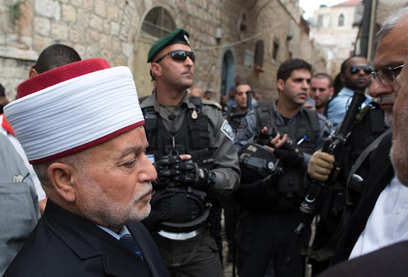 """Grand Mufti of Jerusalem Mohammed Hussein, pictured at the Al-Aqsa mosque compound, says a new cartoon depicting the Prophet Mohammed in Charlie Hebdo magazine insults """"nearly two billion Muslims all over the world"""""""