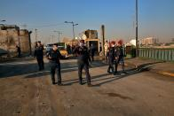 Security forces open anti-government protesters' site at the Joumhouriya Bridge that leads to the Green Zone government areas, in Baghdad, Iraq, Saturday, Oct. 31, 2020. (AP Photo/Khalid Mohammed)