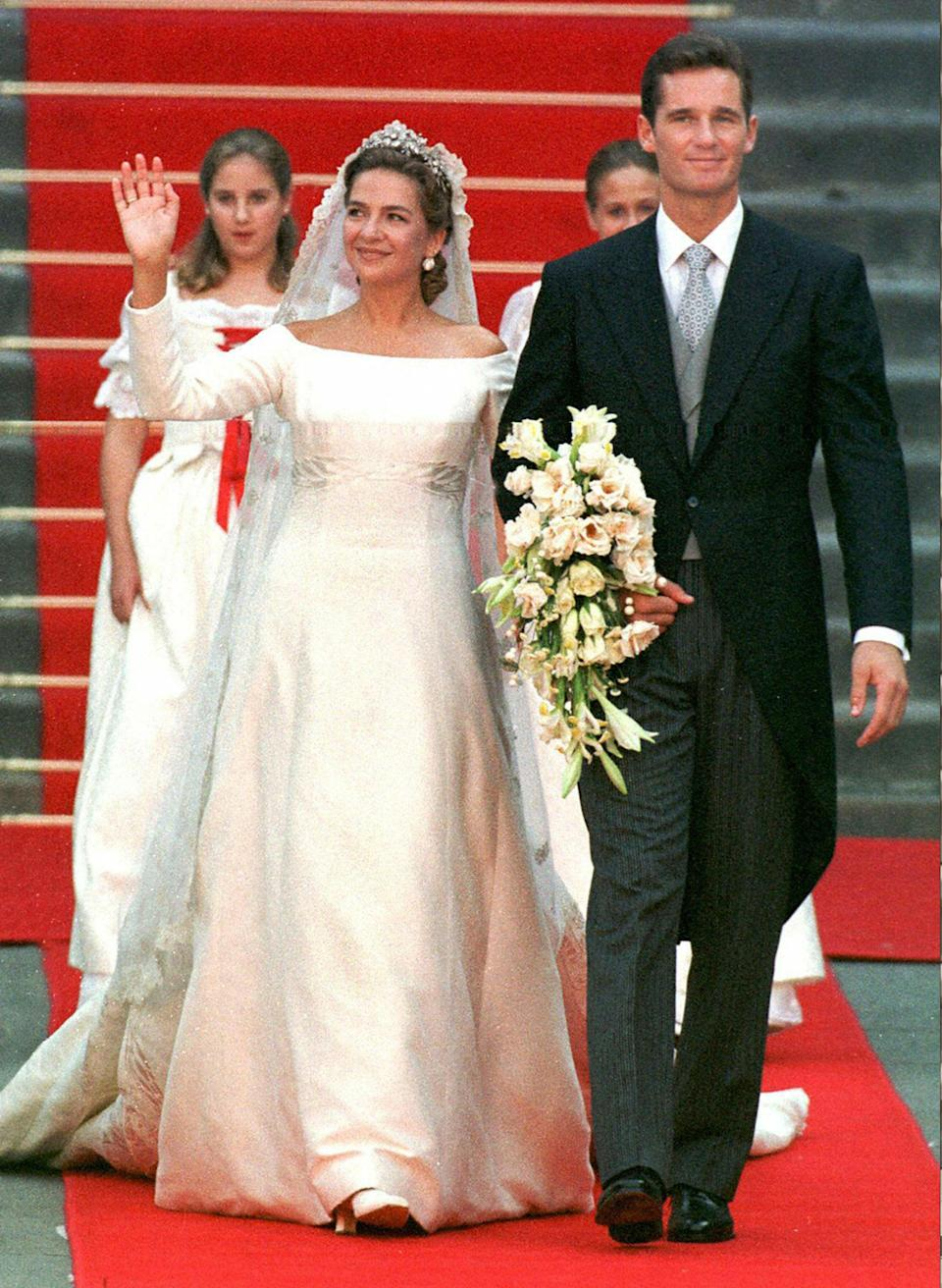Princess Cristina of Spain was the first to break the trend, and wore this off the shoulder design back in 1997. Photo: Getty
