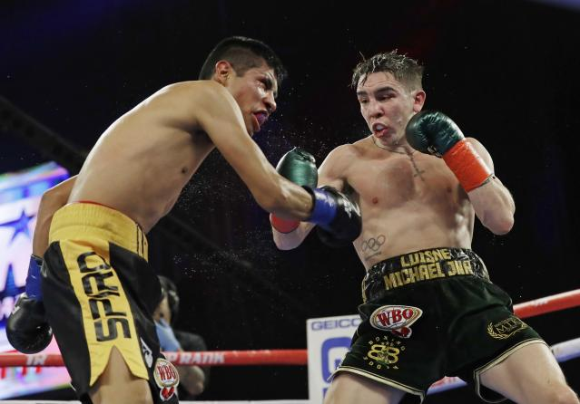 Ireland's Michael Conlan, right, punches Mexico's Ruben Garcia Hernandez during the eighth round of a featherweight boxing match Sunday, March 17, 2019, in New York. Conlan won the bout. (AP Photo/Frank Franklin II)