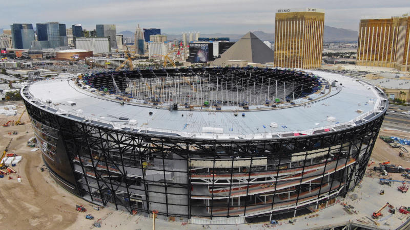 FILE - In this Dec. 18, 2019, file photo, work continues on Allegiant Stadium, future home of the Las Vegas Raiders. Allegiant Stadium will debut on Monday night, Sept. 21, with the Raiders facing Tom Brady and the Tampa Bay Buccaneers. (Michael Quine/Las Vegas Review-Journal via AP, File)