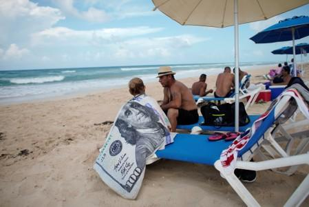 Tourists relax at Santa Maria beach in the outskirts of Havana