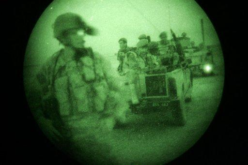 US and Afghan soldiers during a night raid in search of insurgents in Ghazni Province