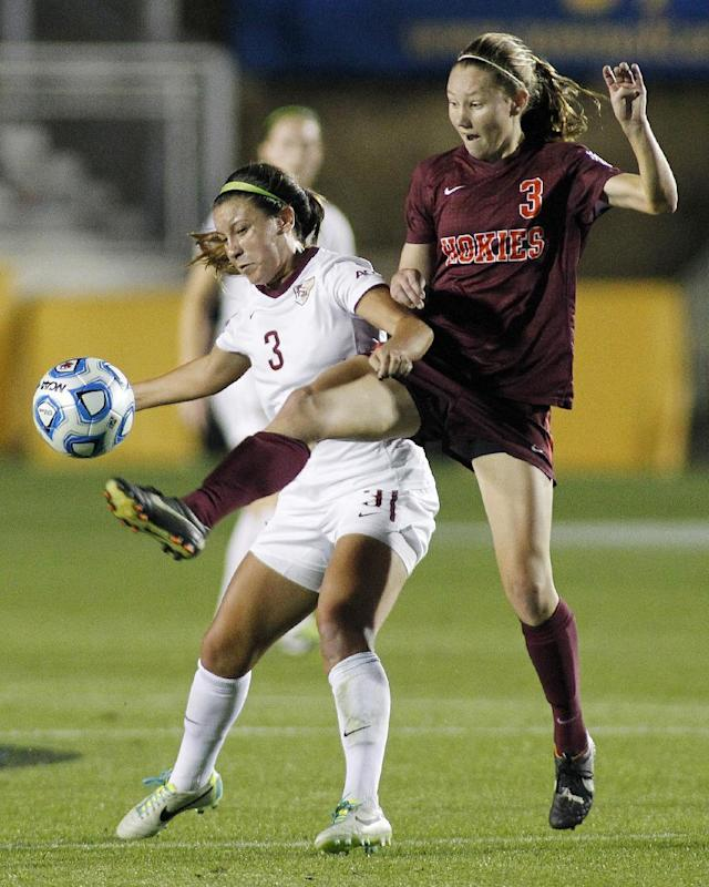 Florida State's Nickolette Driesse, left, battles Virginia Tech's Katie Yensen for the ball during the second half of an NCAA college soccer semifinal match at the Women's College Cup tournament in Cary, N.C., Friday, Dec. 6, 2013. (AP Photo/Ellen Ozier)