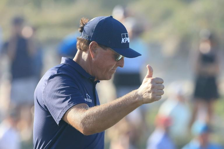 Phil Mickelson gives a thumbs-up on the way to his historic victory in the 2021 PGA Championship