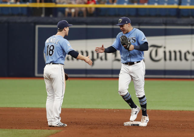 Tampa Bay Rays' Avisail Garcia, right, celebrates with teammate Joey Wendle after a baseball game against the Toronto Blue Jays, Sunday Sept. 8, 2019, in St. Petersburg, Fla. (AP Photo/Scott Audette)