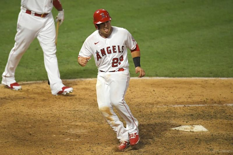 Los Angeles Angels' Matt Thaiss reacts after scoring on a sacrifice fly hit by Michael Hermosillo to win a baseball game during the 10th inning against the Houston Astros Saturday, Aug. 1, 2020, in Anaheim, Calif. (AP Photo/Mark J. Terrill)