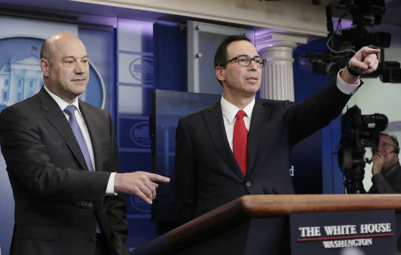 U.S. National Economic Director Gary Cohn (L) and Treasury Secretary Steven Mnuchin unveil the Trump administration's tax reform proposal in the White House briefing room in Washington, U.S, April 26, 2017. REUTERS/Kevin Lamarque