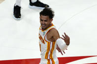 Atlanta Hawks guard Trae Young (11) reacts after an Atlanta basket in the second half of an NBA basketball game against the New Orleans Pelicans Tuesday, April 6, 2021, in Atlanta. (AP Photo/John Bazemore)