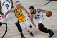Toronto Raptors' Fred VanVleet (23) drives into Los Angeles Lakers' Alex Caruso (4) during the first half of an NBA basketball game Saturday, Aug. 1, 2020, in Lake Buena Vista, Fla. (AP Photo/Ashley Landis, Pool)