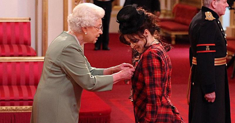 Queen Elizabeth II presents Helena Bonham Carter with her Commander of the British Empire (CBE) medal during an Investiture ceremony at Buckingham Palace in central London.