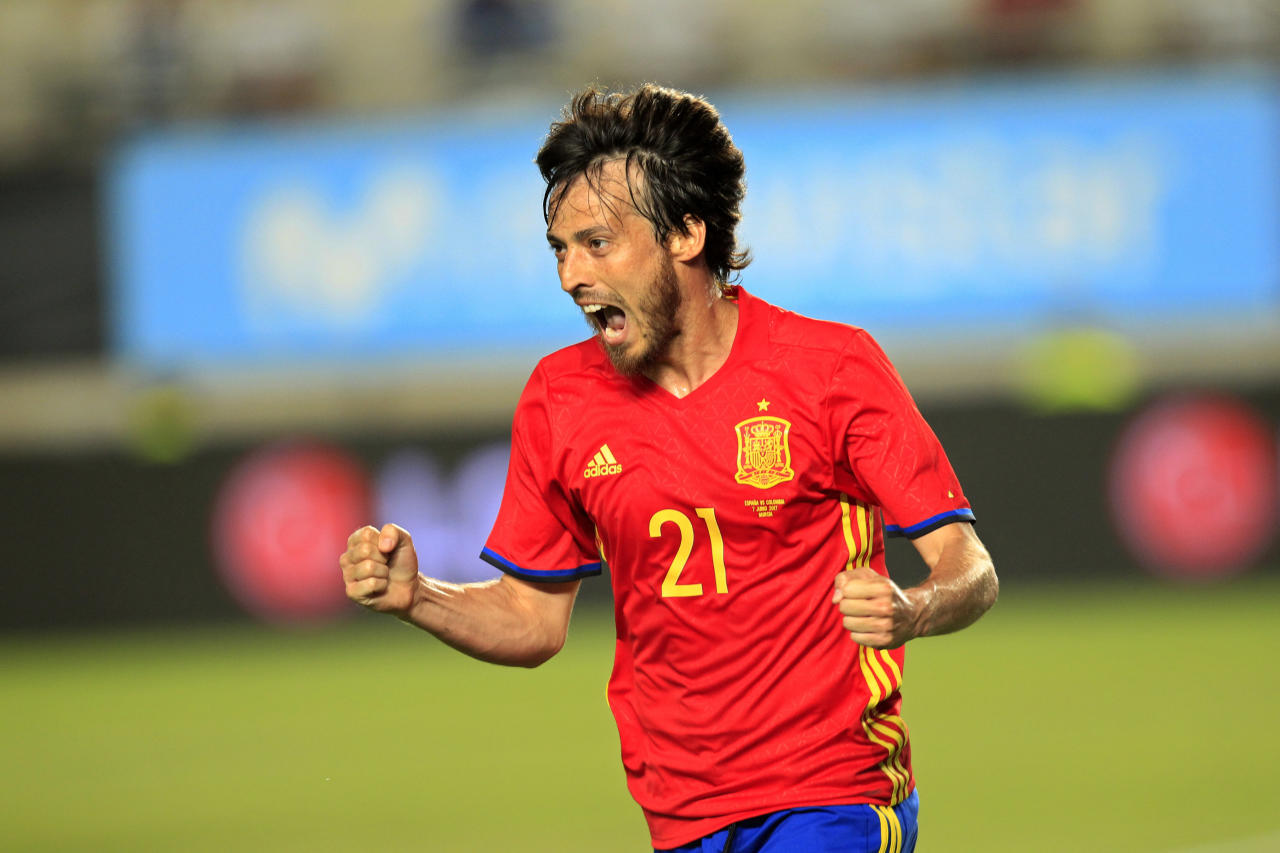 FILE - In this June 7, 2017 file photo, Spain's David Silva celebrates after scoring during the international friendly soccer match between Spain and Colombia at the Estadio Nueva Condomina in Murcia, Spain. The elegance and precise passes of Andres Iniesta, the personality and stout defense of Sergio Ramos and the intelligence and scoring touch of David Silva will all be on display again at the World Cup, but mostly likely for the last time.(AP Photo/Alberto Saiz, File)