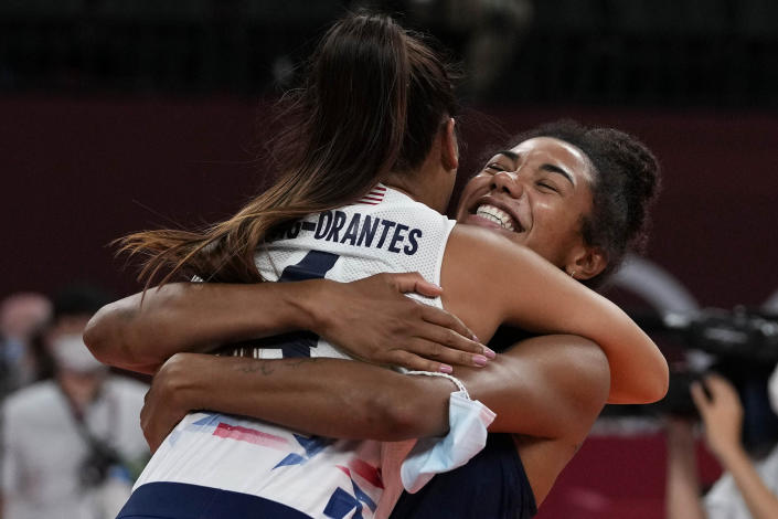 United States' Jordan Thompson, rear, and United States' Justine Wong-Orantes celebrate winning the women's volleyball quarterfinal match between Dominican Republic and United States at the 2020 Summer Olympics, Wednesday, Aug. 4, 2021, in Tokyo, Japan. (AP Photo/Frank Augstein)