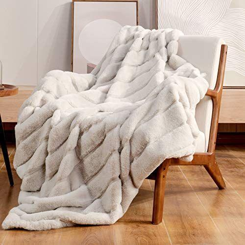 """<p><strong>Cozy Bliss</strong></p><p><strong>$49.99</strong></p><p><a href=""""https://www.amazon.com/dp/B08XYSVBWR?tag=syn-yahoo-20&ascsubtag=%5Bartid%7C10063.g.37611125%5Bsrc%7Cyahoo-us"""" rel=""""nofollow noopener"""" target=""""_blank"""" data-ylk=""""slk:Shop Now"""" class=""""link rapid-noclick-resp"""">Shop Now</a></p><p>As the weather cools down, that means it's time to warm up with a cozy throw, and this premium faux fur throw blanket is just the ticket. The best part? It's available in a few different colors, so there's bound to be an option that fits your home.</p>"""