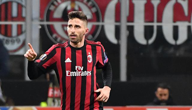 AC Milan's Fabio Borini celebrates after scoring his side's first goal during an Europa League round of 32 second leg soccer match between AC Milan and PFC Ludogorets Razgrad at the Giuseppe Meazza stadium in Milan, Italy, Thursday, Feb. 22, 2018. (Daniel Dal Zennaro/ANSA via AP)