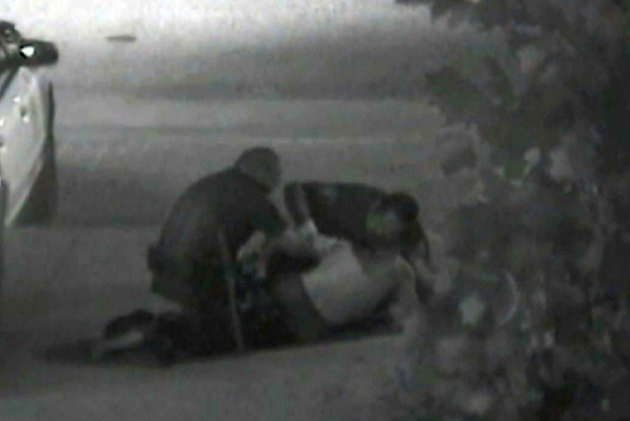 This still photo taken from a security camera released on Monday May 7,2012 by the Orange County District Attorney shows an altercation between Fullerton police officers and homeless Kelly Thomas at the Fullerton bus depot on July 5,2011. The grainy black and white video of Thomas' violent encounter with police outside a bus depot is the centerpiece of the prosecutions' case against two officers accused of escalating a standard police encounter with a homeless man into a fatal beating. (AP Photo/Orange County District Attorney)