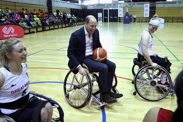 REFILE - CORRECTING TITLE Britain's Prince William and Duchess Catherine meet wheelchair basketball players, some of whom hope to compete in the 2022 Commonwealth Games in Birmingham, during their visit to the Copper Box in the Olympic Park in Stratford, London, Britain, March 22, 2018. Chris Jackson/Pool via Reuters TPX IMAGES OF THE DAY