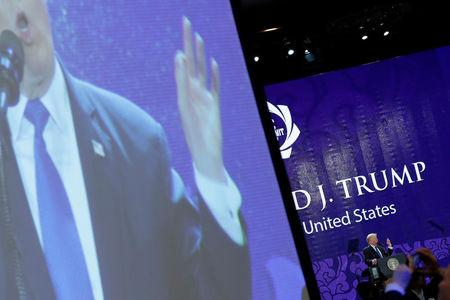 U.S. President Donald Trump appears on a large video screen as he delivers remarks at the APEC CEO Summit in Danang, Vietnam November 10, 2017. REUTERS/Jonathan Ernst