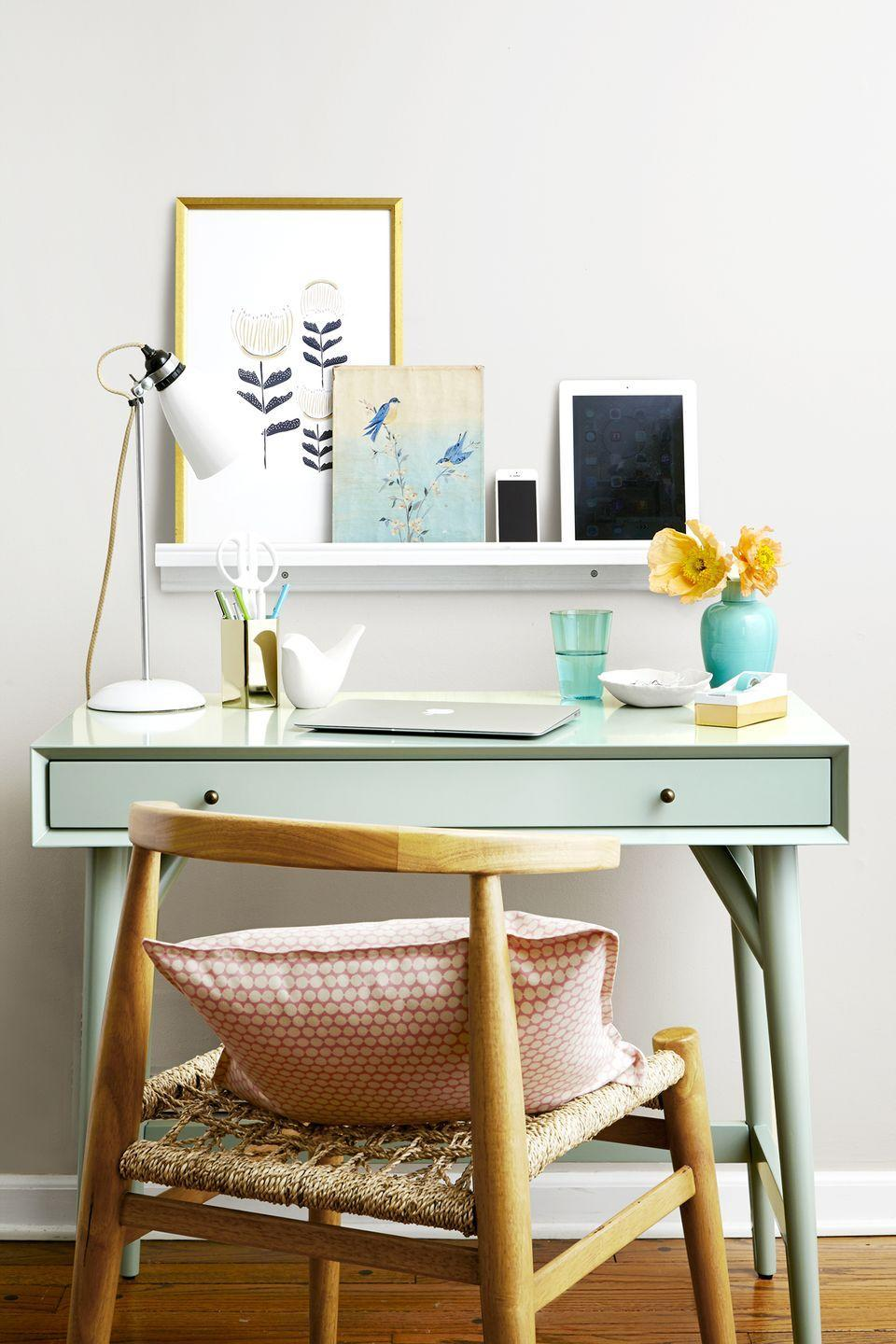 """<p>Expand your workspace by adding a sleek wooden shelf at eye level. The rest is up to you: Display artwork, or use it as a handy storage spot for gadgets.</p><p><strong>RELATED</strong>: <a href=""""https://www.goodhousekeeping.com/home/organizing/g25576393/desk-organization-ideas/"""" rel=""""nofollow noopener"""" target=""""_blank"""" data-ylk=""""slk:18 Desk Organization Ideas That'll Inspire Productivity In Your Office"""" class=""""link rapid-noclick-resp"""">18 Desk Organization Ideas That'll Inspire Productivity In Your Office</a> </p>"""