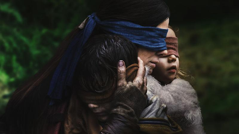 Two actors wearing blindfolds in a scene from the movie Bird Box.
