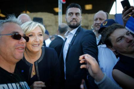 Marine Le Pen, French National Front (FN) political party leader and candidate for French 2017 presidential election, poses with a supporter after a political rally in Pageas, France April 13, 2017. REUTERS/Stephane Mahe