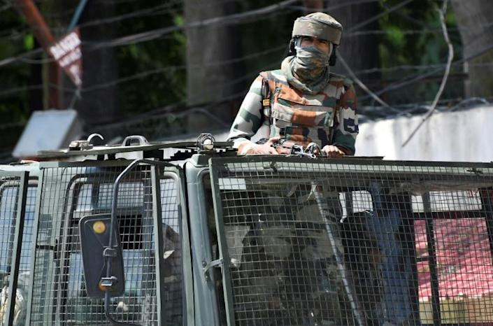Three deaths have been claimed by Kashmiri familes since New Dehli imposed a massive security and communications lockdown on the region (AFP Photo/Punit PARANJPE)