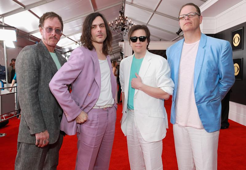 """Every member of Weezer is dressed like they're playing a drug dealer on """"Miami Vice."""""""