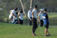 Nick Taylor, back right, talks to a rules official prior to his second shot on the ninth hole during the second round of the Sony Open golf tournament Friday, Jan. 15, 2021, at Waialae Country Club in Honolulu. (AP Photo/Jamm Aquino)