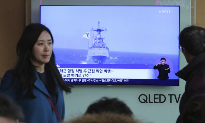 """A TV screen shows file footage of a South Korean warship during a news program at the Seoul Railway Station in Seoul, South Korea, Wednesday, Jan. 23, 2019. South Korea's military accused Japan of a """"clear provocation"""" over what it said was a threatening low-altitude flight by a Japanese patrol plane over a South Korean warship on Wednesday. The Korean letters on the screen read: """"South Korea's military accused Japanese patrol plane of threatening flight"""". (AP Photo/Ahn Young-joon)"""