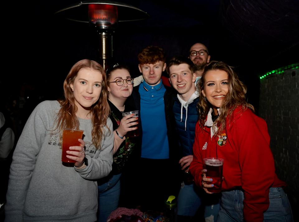 The dedicated patrons of The Oak Inn in Coventry enjoy their first post-lockdown pints and other alcoholic beverages moments after midnight as restrictions across the UK are partially eased. The establishment is licensed till 6am, and also plans to sell food throughout the night, such as pizzas, burgers and kebabs. April 12 2021.